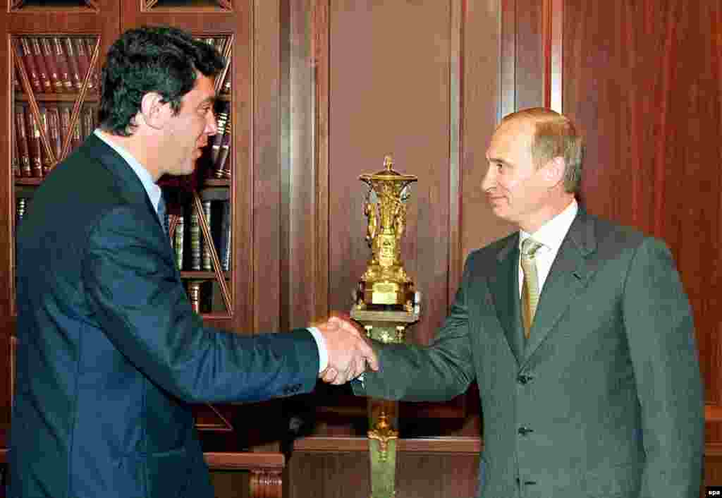 Nemtsov, then a member of the Russian legislature, the State Duma, shakes hands with Russian President Vladimir Putin in the Kremlin in 2000.