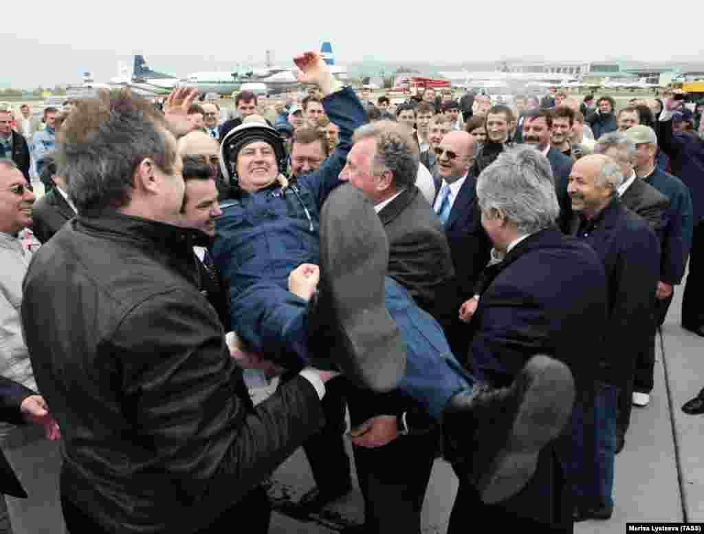 A test pilot is feted by Sukhoi executives after the Superjet's first flight. But celebrations in the company proved short-lived.