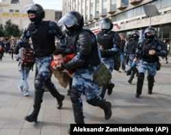 Police forcibly detain a protester during a rally in the center of Moscow on August 3.
