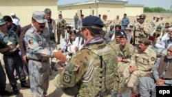 FILE: Afghan National Army (ANA) soldiers and US NATO soldiers attend the opening ceremony of National Directorate of Security (NDS) compound funded by Washington in Lashkar Gah, the provincial capital of Helmand province in April 2014.
