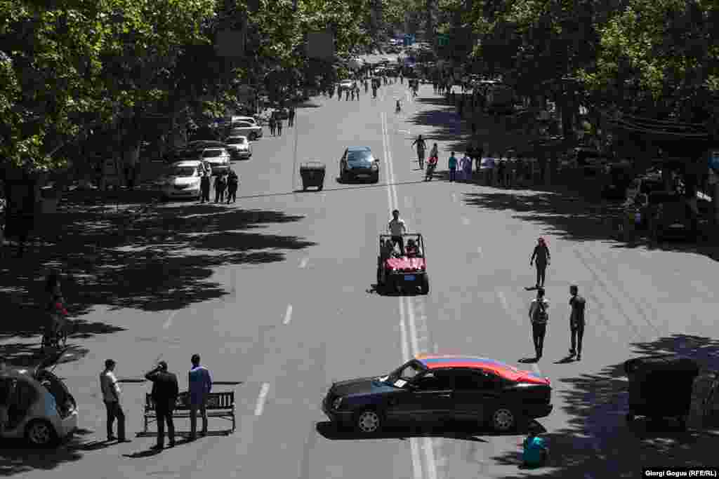 Many streets in the Armenian capital were mostly empty on May 2 as protesters used benches and cars to block traffic.