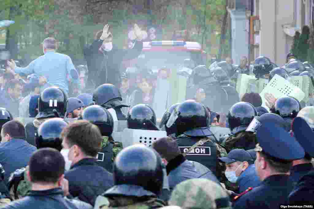 Russian riot police confront crowds protesting against self-isolation orders in Vladikavkaz, North Ossetia, on April 20.