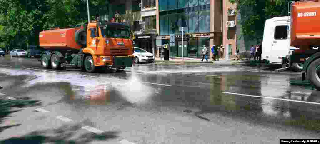 Vehicles spray disinfectant on a road near the site of a planned opposition rally in Almaty.