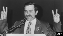 Lech Walesa shows supporters the victory sign at the first Solidarity convention in Gdansk in September 1981.