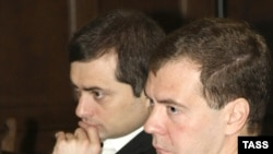 Surkov (left) and Medvedev at a meeting with political party leaders last November.