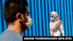 IRAN PANDEMIC CORONAVIRUS COVID19 -- Iranians wearing face masks go shopping around Tehran's grand bazaar in Tehran, Iran, 07 July 2020. Media reports state on 07 July 2020