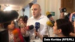 Nika Melia talks to reporters on June 26.
