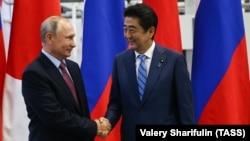 Russian President Vladimir Putin (left) meets with Japanese Prime Minister Shunzo Abe in Vladivostok on September 10.