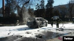 Firefighters in Mariupol extinguish a car in which Colonel Oleksandr Kharaberyush from Ukraine's intelligence service was killed on March 31.