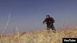 An video grab, published by Syrian rebels, that purports to show an Iranian soldier fighting in Syria.