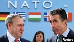 Ukrainian Foreign Minister Andriy Deshchytsya (left) listens to NATO Secretary-General Anders Fogh Rasmussen during a NATO-Ukraine foreign ministers meeting in Brussels on April 1.