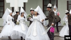 Couples take part in a mass wedding ceremony in the capital Bishkek in 2012.