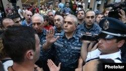 Armenia - Police General Hunan Poghosian (C) speaks to protesters in Yerevan, 18 July 2016.