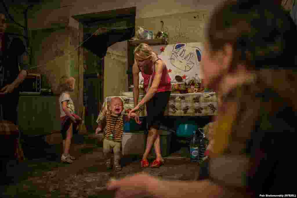 Forty people, including 19 children, live in the shelter. In spite of a cease-fire agreement that went into force in February, there has been little respite from the bombing and shelling that have ravaged Donetsk, and residents are afraid to sleep in their own homes at night.