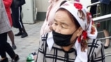 Kazakhstan - A woman is sitting in front of the bank said that she came to create a bank account. Kyzylorda, 6 April 2020