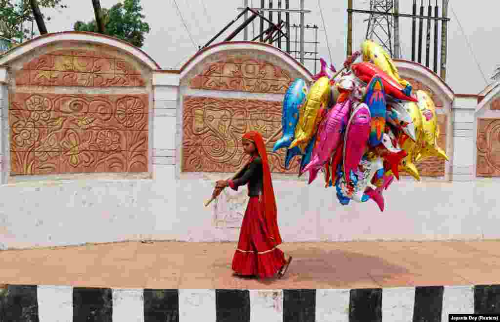 A girl sells balloons on the outskirts of Agartala, India. (Reuters/Jayanta Dey)