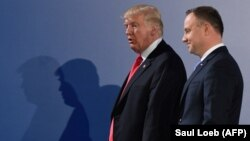 Polish President Andrzej Duda (right) and U.S. President Donald Trump after talks in Warsaw on July 6, 2017