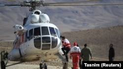 Rescue workers search for a plane that crashed in a mountainous area of central Iran on February 18.