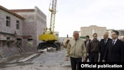 Armenia -- Prime Minister Tigran Sarkisian (R) inspects government-financed homes built in Stepanavan, 29Dec2010.