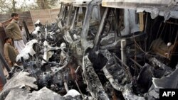 Burned-out vehicles at a NATO supply camp in Peshawar on December 1.