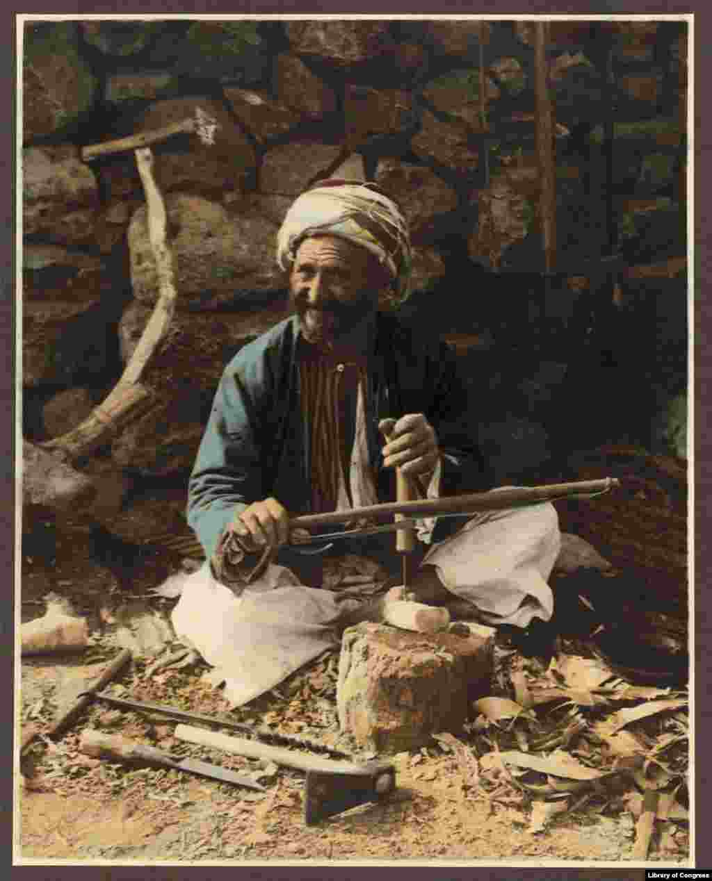 Traditional crafts still thrived in 1919 -- here, a village carpenter makes ploughs.