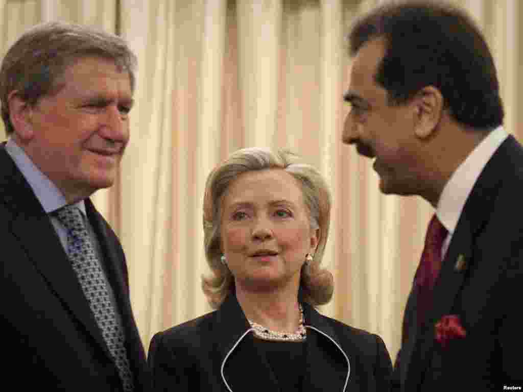 Holbrooke with U.S. Secretary of State Hillary Clinton and Pakistan's Prime Minister Yusuf Raza Gilani during a visit to Islamabad on July 18, 2010.