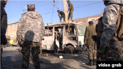 Military personnel at the scene of a suicide bombing in Kabul that killed six soldiers.