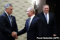 Russian President Vladimir Putin greets Huntsman during a meeting with U.S. Secretary of State Mike Pompeo (right) at the Bocharov Ruchei residence in Sochi on May 14.