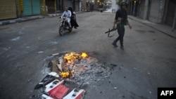 На месте столкновений в Каире 6 октября 2013 г.