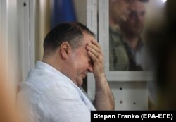 Borys Herman, accused by authorities of hiring someone to assassinate Babchenko, reacts in a Kyiv courtroom on May 31.