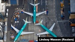 U.S. -- An aerial photo shows Boeing 737 MAX airplanes parked on the tarmac at the Boeing Factory in Renton, Washington, U.S. March 21, 2019
