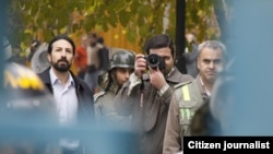Iran -- A citizen journalist's photograph of plainclothes police's surveillance of Iranian demonstrators around Art University, Tehran, 07Dec2009