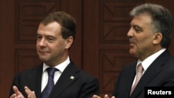 Turkish President Abdullah Gul (right) and his Russian counterpart, Dmitry Medvedev, in Ankara today