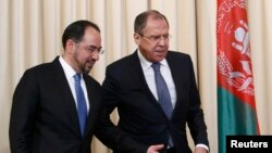 Russian Foreign Minister Sergei Lavrov and his Afghan counterpart Salahuddin Rabbani (left)