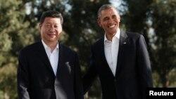 "АҚШ президенті Барак Обама (оң жақта) мен Қытай басшысы Си Цзиньпин. ""Мираж"" ранчосы, Калифорния, АҚШ, 7 маусым 2013 жыл."