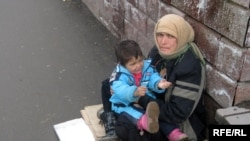 A Roma woman begs in Almaty.