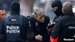 Ոստիկանները Բրյուսելի Շերբեք արվարձանում, 25-ը մարտի, 2016թ․