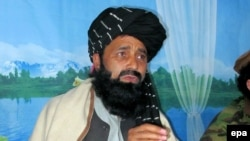 Azam Tariq, a spokesman of the banned militant group Tehrik-e Taliban Pakistan, speaks at an undisclosed location near the Afghan border in February 2014.