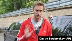 Aleksei Navalny greets colleagues as he leaves a detention center in Moscow on June 14.