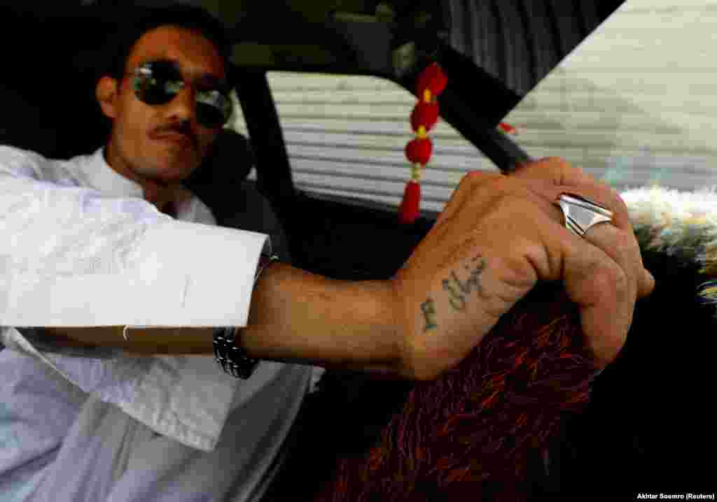 A taxi driver in Hazara Town. The man's tattoo features the name of a friend who was killed in a bomb blast.