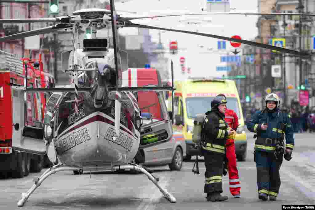 Emergency vehicles and a helicopter are seen outside the St. Petersburg Metro's Tekhnologichesky Institut station.