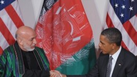U.S. President Barack Obama (right) and Afghan President Hamid Karzai (file photo)
