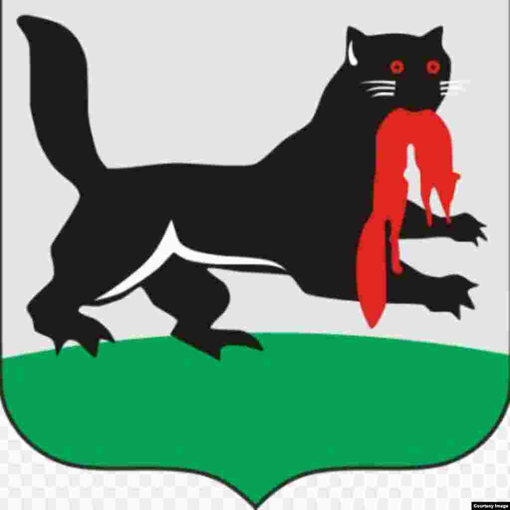 The flag of Irkutsk featuring an unknown creature that appears, according to Russia-watcher Michael Elgort, to be a beaver with the legs of a platypus holding a fox in its mouth. (Looks more like a cat of some kind than a beaver to us, but no matter.)
