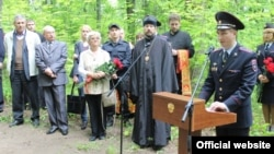 Local dignitaries and the granddaughter of NKVD officer Valter Vand attend the unveiling of a monument to victims of Stalin's Great Terror in Saransk.