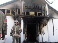 The offices of the state-owned 'Serdalo' newspaper were set on fire following the demonstration (AFP)
