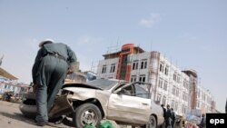 Afghan security official inspects the site of a bomb blast in northern Afghanistan. (file photo)