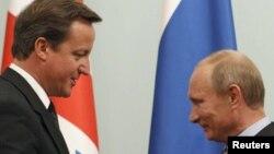 Cameron & Putin - foto arkivi