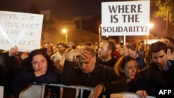 Cypriot bank employees have protested government actions aimed at securing a 10 billion euro bailout.
