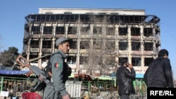 Afghan policemen in front of the Kabul shopping mall where Taliban gunmen battled security forces for hours on January 18.