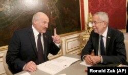 Belarusian President Alyaksandr Lukashenka talks with Austrian President Alexander Van der Bellen during their meeting in Vienna on November 12.